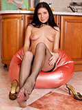Nubiles.net Alma - Shapely babe with titillating legs clad with fishnet stockings spreads eagle revealing her pink