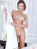 Dila Dips Her Fingers Into Her Clean Shaved Pussy - Picture 2