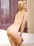 Gorgeous Nubile Irina Ann Takes Off Her Panties And Flaunts Her Sweet Teen Pussy On The Couch - Picture 8