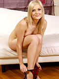 Gorgeous Nubile Irina Ann Takes Off Her Panties And Flaunts Her Sweet Teen Pussy On The Couch - Picture 9