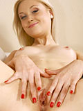 Gorgeous Nubile Irina Ann Takes Off Her Panties And Flaunts Her Sweet Teen Pussy On The Couch - Picture 15