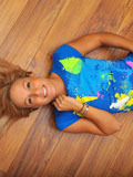 Gorgeous Teen Temptress Lying On The Floor Decides To Get Naked And Play With Her Blue Rabbit Toy - Picture 1
