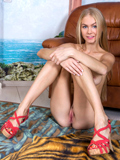 Long Legged Model Shows Off Her Naughty Side As She Masturbates - Picture 5