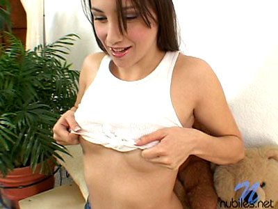 Long haired celeste lifts up her white shirt and plops her tits out