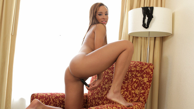 Gorgeous mocha skinned Nubile squirms with orgasmic pleasurevideo